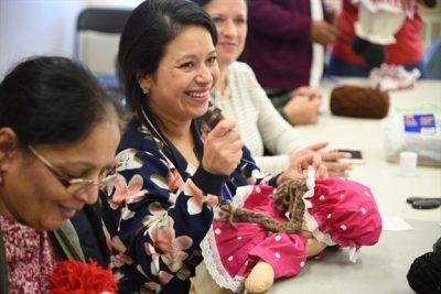 Women from around the world sew multicultural dolls for children with FACS Niagara